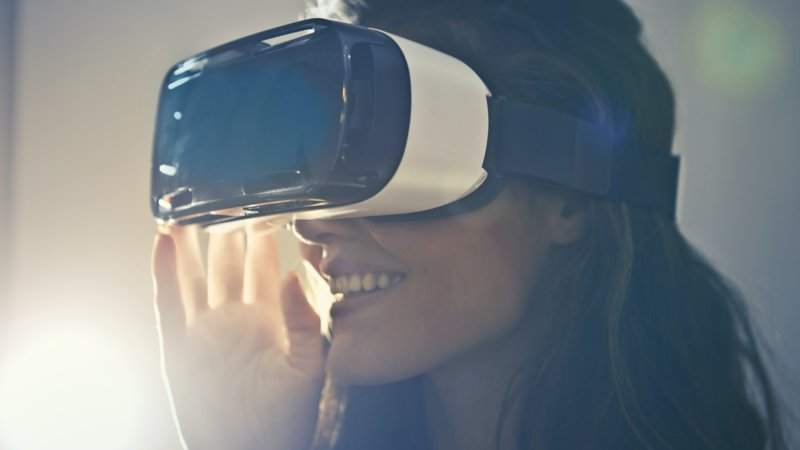 virtual reality marketing becoming the go to with the use of VR headsets, see woman using this technology